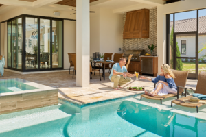 Couple enjoying their poolside patio with hurricane resistant windows